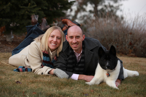 Dentists Elizabeth and Travis with a dog in Spokane.